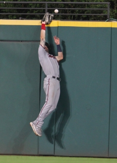 Jake Clave attempting unsuccessfully to catch a home run by Kipnis