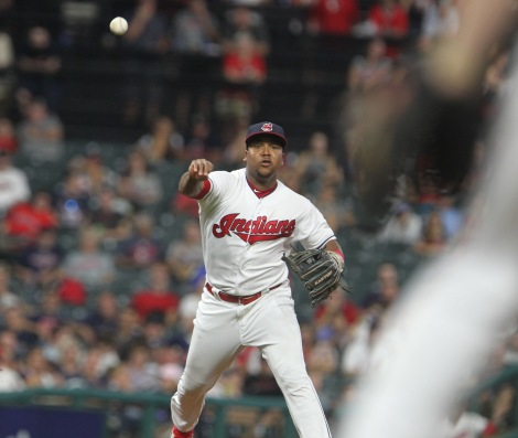 Jose Ramirez throwing to first base on the run